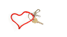 A key with Red strap Heart-Shaped Stock Photography