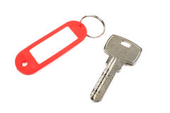 Key and red trinket. Stock Image