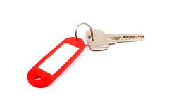 Key and red trinket. Stock Photos