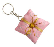 Key ring. Pink pillow shape with gold bow Royalty Free Stock Photography