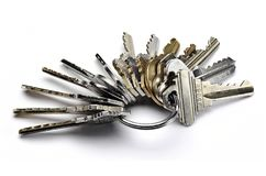 Key Ring. Close up of metal key ring with many worn keys isolated on white stock photos