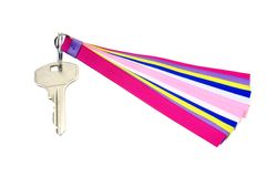 Key on the ring with colorful ribbons Royalty Free Stock Images
