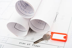 Key and Rolls of Blueprints Stock Image