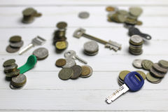 Key and russian coins on background Stock Photos