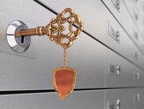 Key in the safe deposit box Stock Photos