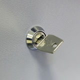 Key in the safe deposit Royalty Free Stock Image