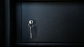 Key in a safe door. Key in the internal section of the safe protected by one more door. The external door is closed. Close up stock footage