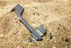 Key and sand Stock Photos