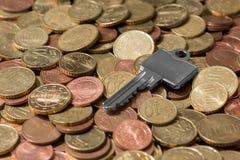 Key on saved money Royalty Free Stock Photography