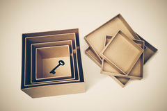 A key in secret boxes. / Hidden secret concept royalty free stock photo