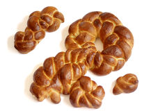 Key shape challah with small challot. Key shape Challah is a symbol of good wealth made at the first Shabbat after Pesach. A Jewish tradition stock photo
