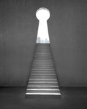 Key shape door on concrete wall with stairs and city view outsid. Key shape door on concrete wall interior with stairs and city view outside Stock Photography