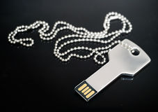 Key shaped USB drive. Macro image of a key-shaped USB drive in concept of technology security Royalty Free Stock Photos