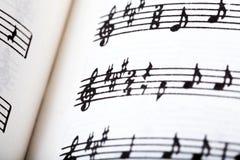 Key signature symbol and violin clef. Musical notation macro, closeup. Single line sheet music detail example