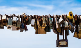 Key with sling. Love key lock on the sling with blue sky background Royalty Free Stock Photo
