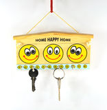 Key stand. Wooden key stand with faces of smiley and keys Stock Images