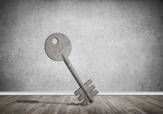 Conceptual background image of concrete key sign in room with wo. Key stone figure as symbol of access in empty concrete room Stock Photo