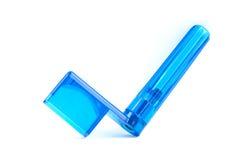 Key for strings. Plastic key for winding the strings blue stock image
