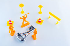 Key success maker by toy figure on white floor Royalty Free Stock Photos