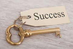 Key with success tag on table Royalty Free Stock Image