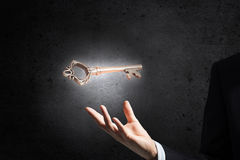 Key symbol in hand Royalty Free Stock Image