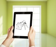 Key on tablet Stock Photography