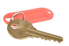 Key with a tag. A key with a red tag on white Stock Photos