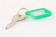 Key with tag. Isolated on white background Royalty Free Stock Photo