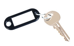 Key with tag. Key with black tag and copy space, isolated on white background Royalty Free Stock Photo