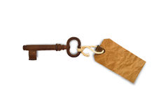 Key with tag. An old rusty key with a blank paper tag isolated on white studio background Stock Images