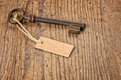 Key with a tag on a wooden board Stock Photos