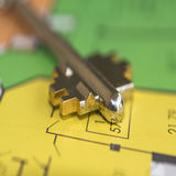 The key to the apartment and the drawing of a new residential building Stock Photo
