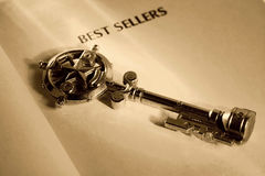 Key To a Best Seller. Key and a Book.  Key To a Best Seller Concept Stock Photos