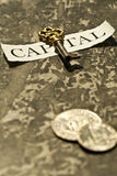 The key to capital. And coins Royalty Free Stock Image