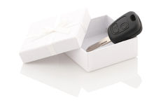 The key to the car in a white gift box on a white background Stock Images