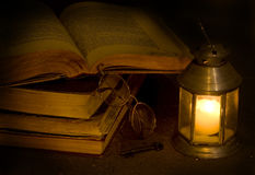 Key to dreamland. Open antique books the darkness of night Royalty Free Stock Images