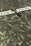 The key to education. On the table Stock Photos