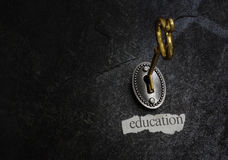 Key to education. Gold key opening a lock, with education message Royalty Free Stock Image