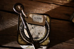 Key to the Future . Label and key on wooden table, vintage, toned photo Stock Image