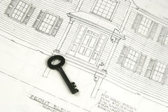 Key to future new home. Key to futer new home with architectural drawing in the background Royalty Free Stock Photography