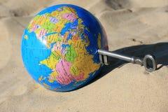 Earth globe. A skeleton key open or close the world Stock Photos