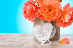 Key to happiness - arrangement with heart, key and orange roses Stock Photography
