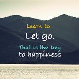 Key to Happiness. Learn to Let go, That is the key to happiness  - inspiration quote on nature background Stock Image