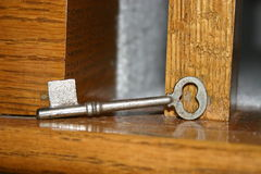 Key to the Heart. Heart shaped skeleton key on wood background Royalty Free Stock Photos