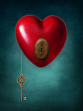 Key to the heart. Key with the heart as symbol of love Royalty Free Stock Photo