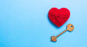 Key to heart and love. Golden Key to a red heart on a blue background. Love Valentine`s Day Stock Photos