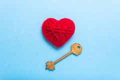 Key to heart and love. Golden Key to a red heart on a blue background. Love Valentine`s Day Royalty Free Stock Images