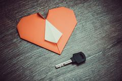 Key to heart symbol of love. Concept dating close up Stock Photos