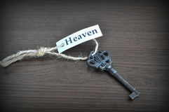 The key to heaven. Key on the table with a note written on it key to heaven; key to heaven Royalty Free Stock Images
