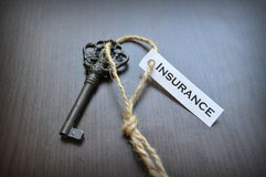 The key to insurance. Key on the table with a note written on it key to insurance; key to insurance Royalty Free Stock Photos